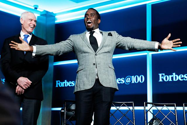 """<p>The man of many names — Puff Daddy, Diddy, Puffy, whatever you call him — was absolutely thrilled to be at the Forbes Media Centennial Celebration in New York. We're guessing he was thinking of his status as <a href=""""https://www.yahoo.com/gma/sean-diddy-combs-forbes-highest-paid-celebrity-235203913--abc-news-music.html"""" data-ylk=""""slk:the most highly paid entertainer"""" class=""""link rapid-noclick-resp newsroom-embed-article"""">the most highly paid entertainer</a> in the world this year, according to the magazine, at this very moment. (Photo: Taylor Hill/Getty Images) </p>"""
