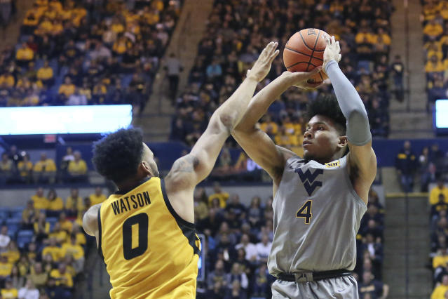 West Virginia guard Miles McBride (4) goes to make a shot as he is defended by Missouri guard Torrence Watson (0) during the second half of an NCAA college basketball game Saturday, Jan. 25, 2020, in Morgantown, W.Va. (AP Photo/Kathleen Batten)