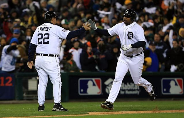 DETROIT, MI - OCTOBER 28: Delmon Young #21 of the Detroit Tigers high-fives third base coach Gene Lamont #22 as he rounds third base after hitting a home run to right field against Matt Cain #18 of the San Francisco Giants in the sixth inning during Game Four of the Major League Baseball World Series at Comerica Park on October 28, 2012 in Detroit, Michigan. (Photo by Doug Pensinger/Getty Images)