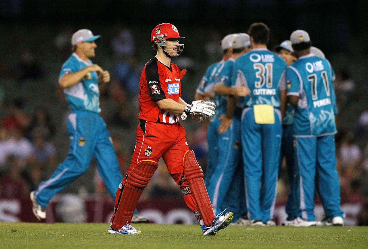 MELBOURNE, AUSTRALIA - DECEMBER 22: Heat players celebrate the wicket of Daniel Harris of the Renegades during the Big Bash League match between the Melborune Renegades and the Brisbane Heat at Etihad Stadium on December 22, 2012 in Melbourne, Australia.  (Photo by Michael Dodge/Getty Images)