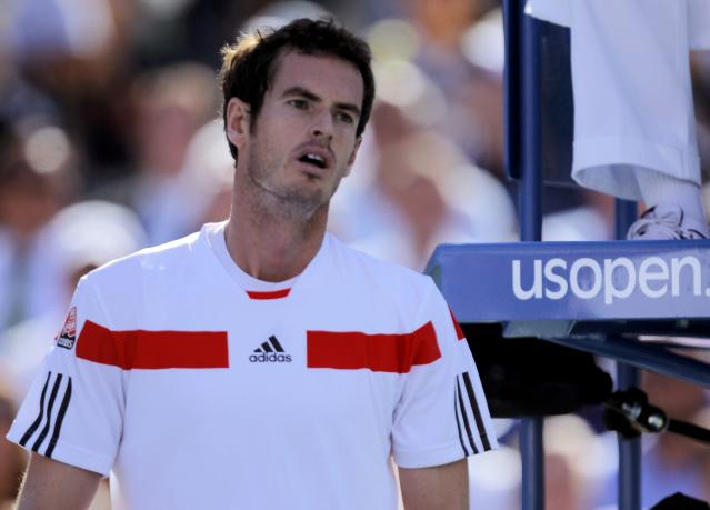 Andy Murray of Britain reacts after a missed point against Stanislas Wawrinka of Switzerland at the U.S. Open tennis championships in New York September 5, 2013. REUTERS/Eduardo Munoz (UNITED STATES - Tags: SPORT TENNIS)