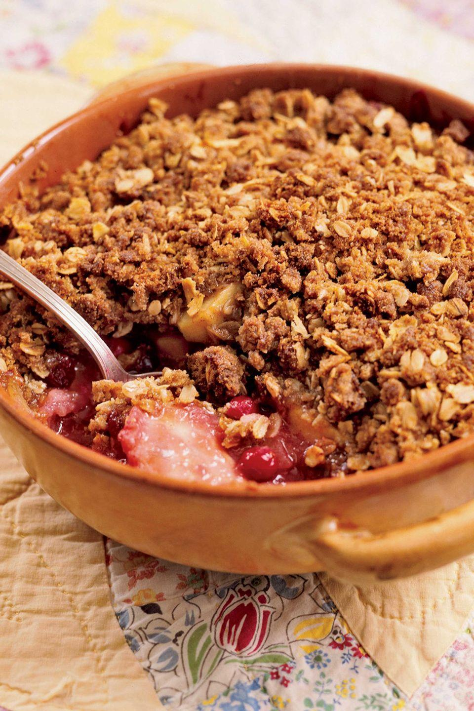 "<p>Try this simple and satisfying dessert with all the best flavors of the season.</p><p><strong><a href=""https://www.countryliving.com/food-drinks/recipes/a1930/cranberry-apple-crisp-clv1007/"" rel=""nofollow noopener"" target=""_blank"" data-ylk=""slk:Get the recipe"" class=""link rapid-noclick-resp"">Get the recipe</a>.</strong></p>"