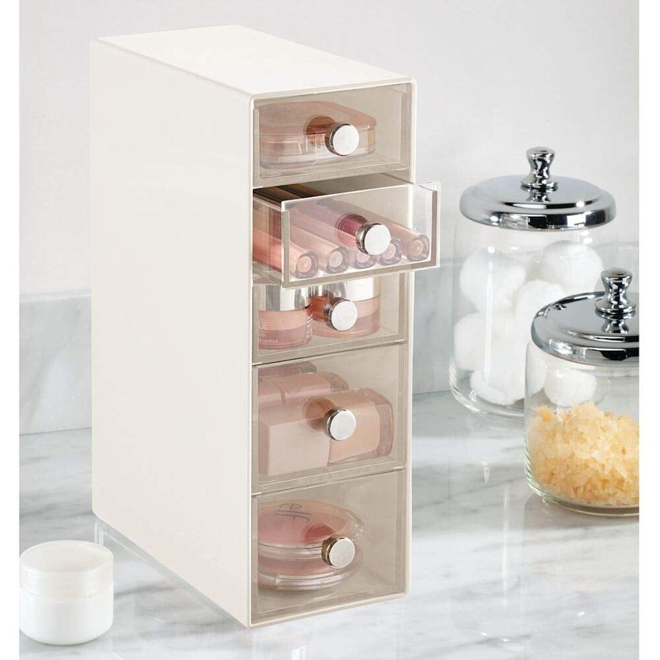 """<p>This <a href=""""https://www.popsugar.com/buy/mDesign%20Plastic%20Cosmetic%20Storage%20Organizer-474632?p_name=mDesign%20Plastic%20Cosmetic%20Storage%20Organizer&retailer=amazon.com&pid=474632&price=17&evar1=casa%3Aus&evar9=46444800&evar98=https%3A%2F%2Fwww.popsugar.com%2Fhome%2Fphoto-gallery%2F46444800%2Fimage%2F46445063%2FmDesign-Plastic-Cosmetic-Storage-Organizer&list1=shopping%2Corganizing%2Cbathrooms%2Chome%20organization%2Chome%20shopping&prop13=mobile&pdata=1"""" rel=""""nofollow"""" data-shoppable-link=""""1"""" target=""""_blank"""" class=""""ga-track"""" data-ga-category=""""Related"""" data-ga-label=""""https://www.amazon.com/mDesign-Cosmetic-Organizer-Bathroom-Counters/dp/B07SLC939Z/ref=sr_1_83?crid=LY9KI2W40HJP&amp;keywords=bathroom+organizer&amp;qid=1564679511&amp;s=gateway&amp;sprefix=bathroom+or%2Caps%2C202&amp;sr=8-83"""" data-ga-action=""""In-Line Links"""">mDesign Plastic Cosmetic Storage Organizer</a> ($17) is great for beauty products, and the thin silhouette is easy to fit on your counter.</p>"""