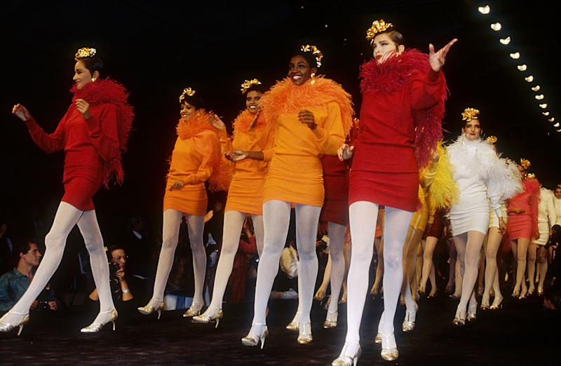 Japanese designer Kenzo Takada shows his women's 1991 spring-summer ready-to-wear line in Paris. The models are wearing short, colorful dresses with matching feather boas. (Photo by Pierre Vauthey/Sygma/Sygma via Getty Images)