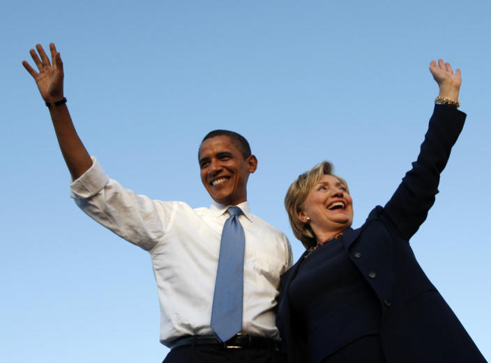 <p>Democratic presidential nominee Sen. Barack Obama and Sen. Hillary Clinton wave to the crowd at a campaign rally in Orlando, Fla., in October 2008. (Photo: Jim Young/Reuters)</p>