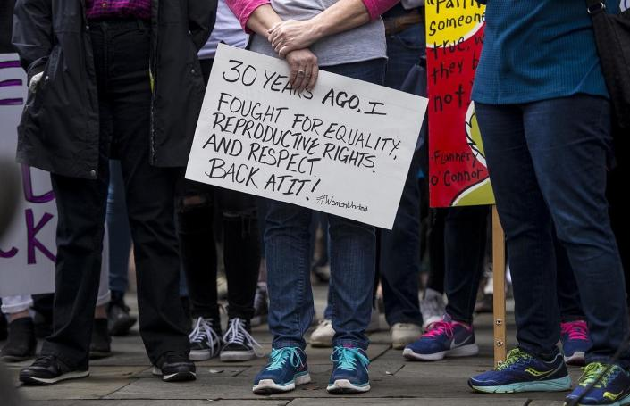 <p>A protest carries a sign in Johnson Square during a rally prior the Women's March Saturday, Jan. 21, 2017, in Savannah, Ga. (Josh Galemore/Savannah Morning News via AP) </p>