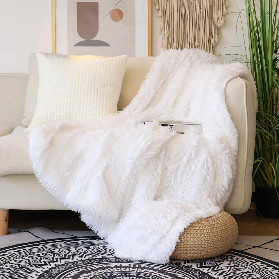 <p>We can't wait to cuddle up in this <span>Decorative Extra Soft Faux Fur Throw Blanket</span> ($20).</p>