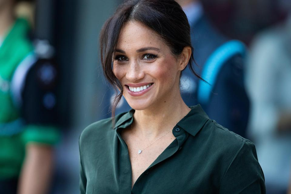 <p>Meghan Markle is writing a book about father and son relationships</p> (Getty Images)
