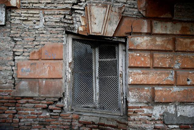<p>A window of an abandoned part of an old house is seen in the old town, Tbilisi, Georgia, April 6, 2017. (Photo: David Mdzinarishvili/Reuters) </p>