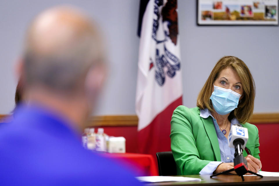 In this Sept. 2, 2021, photo Rep. Cindy Axne, D-Iowa, speaks about the Rural Reinvestment Task Force during a meeting with local officials in Indianola, Iowa. (AP Photo/Charlie Neibergall)