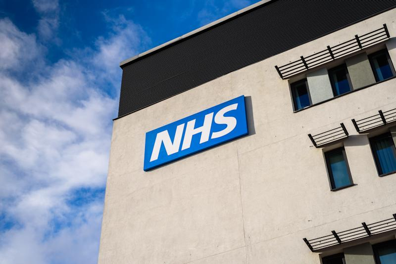 Warrington, United Kingdom - March 6, 2016: Warrington, UK - march 6, 2016: View of the NHS (National Health Service) logo at the Springfields Medical Centre in the centre of Warrington, Cheshire.
