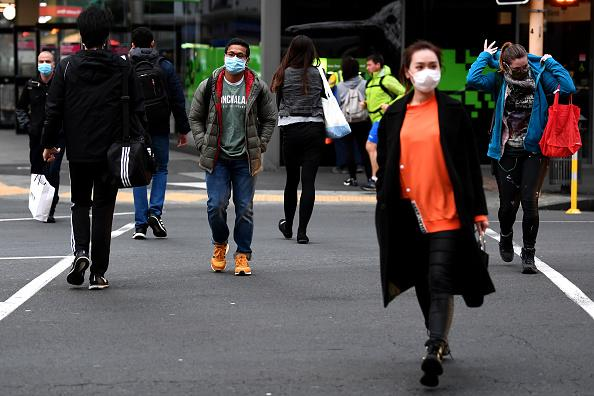 Members of the public wear face masks in Auckland, New Zealand.
