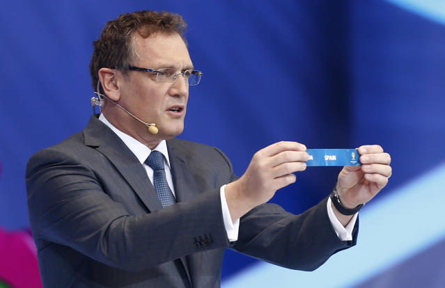 FIFA Secretary General Jerome Valcke holds the ticket of Spain during the draw ceremony for the 2014 soccer World Cup in Costa do Sauipe near Salvador, Brazil, Friday, Dec. 6, 2013. (AP Photo/Victor R. Caivano)