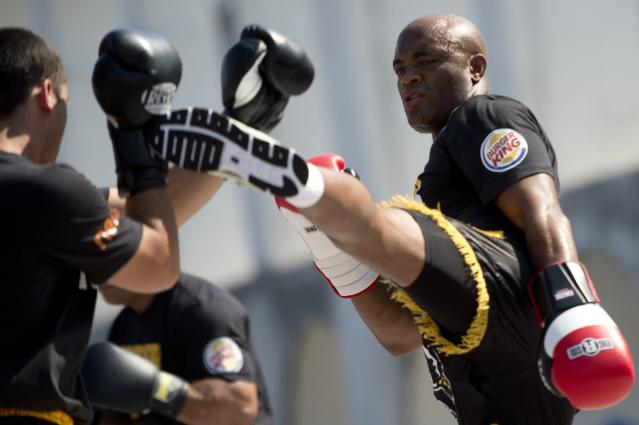 Brazilian MMA-UFC fighter Anderson Silva (R) practices with a sparring in Lapa, Rio de Janeiro, Brazil on October 10, 2012. Silva will fight against US Stephan Bonnar on 13th october. AFP PHOTO / Christophe SimonCHRISTOPHE SIMON/AFP/GettyImages