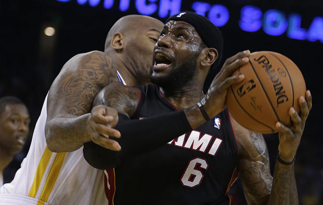 Miami Heat's LeBron James (6) drives the ball against Golden State Warriors' Marreese Speights during the first half of an NBA basketball game on Wednesday, Feb. 12, 2014, in Oakland, Calif. (AP Photo/Ben Margot)