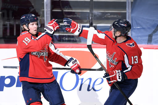 Washington Capitals center Nicklas Backstrom (19) celebrates his goal with left wing Jakub Vrana (13) during the first period of an NHL hockey game against the Buffalo Sabres, Friday, Jan. 22, 2021, in Washington. (AP Photo/Nick Wass)