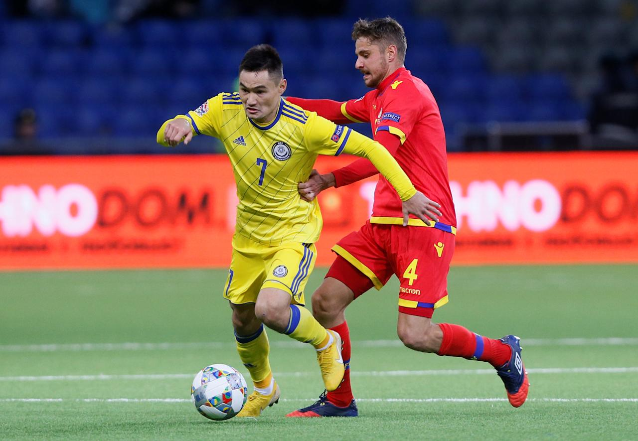 Soccer Football - UEFA Nations League - League D - Group 1 - Kazakhstan v Andorra - Astana Arena, Astana, Kazakhstan - October 16, 2018   Kazakhstan's Serikzhan Muzhikov in action with Andorra's Marc Rebes       REUTERS/Alexei Filippov