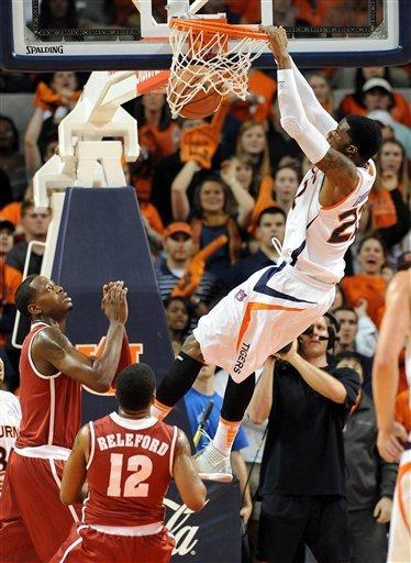 Auburn's Kenny Gabriel dunks the ball over Alabama's Trevor Releford (12) and JaMychal Green in the first half of an NCAA college basketball game in Auburn, Ala., Tuesday, Feb. 7, 2012. Gabriel was called for a technical foul for hanging from the rim. (AP Photo/The Birmingham News, Mark Almond) MAGS OUT