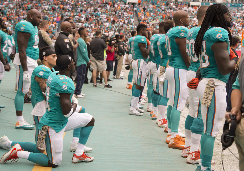 Miami Dolphins Safety Michael Thomas (31) and Miami Dolphins Wide Receiver Kenny Stills (10) kneel in protest during signing of the National Anthem during the NFL football game between the New York Jets and the Miami Dolphins on November 6, 2016, at the Hard Rock Stadium in Miami Gardens, FL. (Photo by Doug Murray/Icon Sportswire via Getty Images)