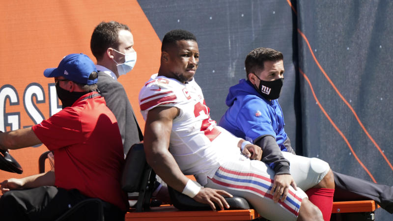 New York Giants running back Saquon Barkley (26) left Sunday's game on a cart after suffering a knee injury. (AP Photo/Nam Y. Huh)