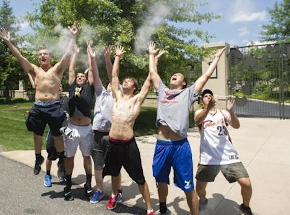 Cavaliers fans celebrate in front of the house of LeBron James. (AP)