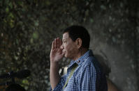 """FILE - In this Wednesday Dec. 13, 2018, file photo Philippine President Rodrigo Duterte salutes to soldiers during a ceremony to destroy hundreds of guns and weapons confiscated from pro-Islamic State group siege in Marawi, southern Philippines at the Philippine Army Headquarters in Manila, Philippines. International Criminal Court judges on Wednesday Sept. 15, 2021, authorized an investigation into the Philippines' deadly """"war on drugs"""" campaign, saying the crackdown """"cannot be seen as a legitimate law enforcement operation."""" (AP Photo/Aaron Favila)"""