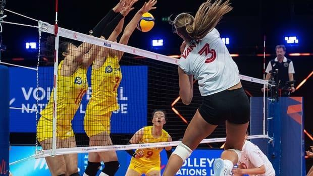Opposite hitter Kiera van Ryk, right, keyed Canada's five-set victory over China, the reigning Olympic champions, on Tuesday in Volleyball Nations League play in Rimini, Italy. The Canadians (1-4) face Germany on Wednesday at 6:45 a.m. ET. (Submitted by volleyballworld.com - image credit)