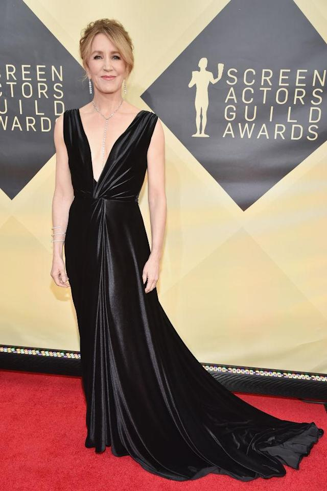 <p>Huffman stunned in a black velvet gown with a plunging neckline. (Photo: Getty Images) </p>
