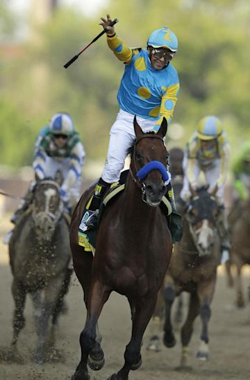 Victor Espinoza rides American Pharoah to victory in the 141st running of the Kentucky Derby. (AP)