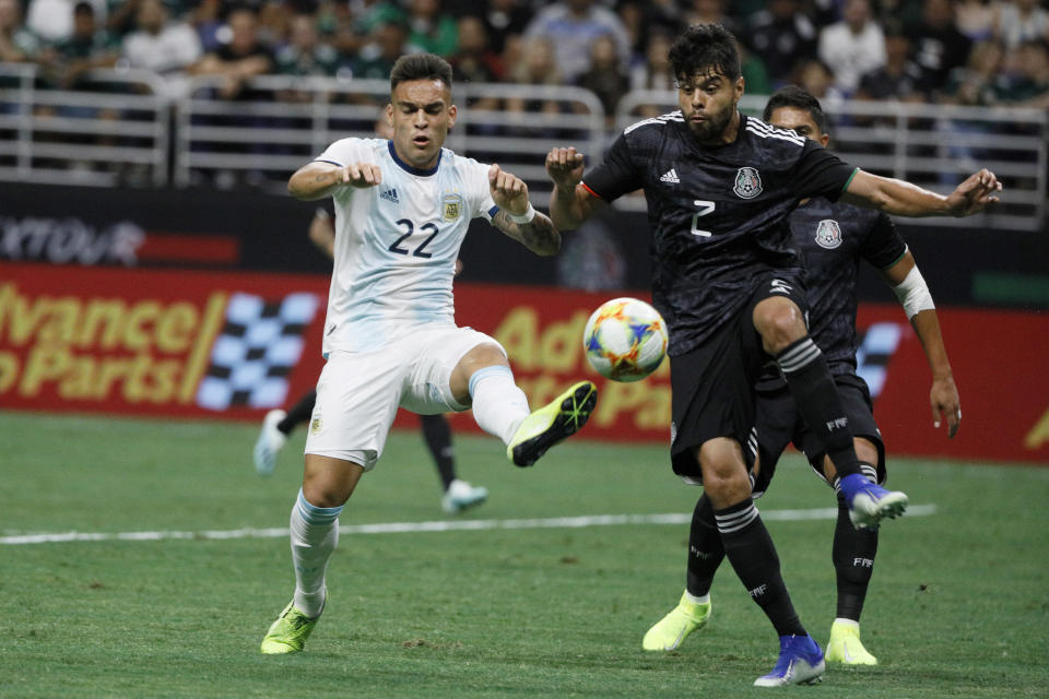 Sep 10, 2019; San Antonio, TX, USA; Argentina Lautaro Mart'nez (22) controls the ball against Mexico defender Nestor Araujo (2) at Alamadome. Mandatory Credit: Soobum Im-USA TODAY Sports