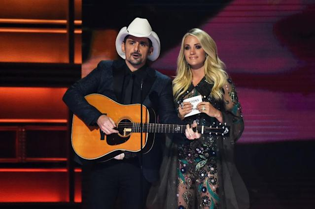 <p>Co-hosts Brad Paisley and Carrie Underwood speak onstage at the 51st annual CMA Awards at the Bridgestone Arena on November 8, 2017 in Nashville, Tennessee. (Photo by John Shearer/WireImage) </p>