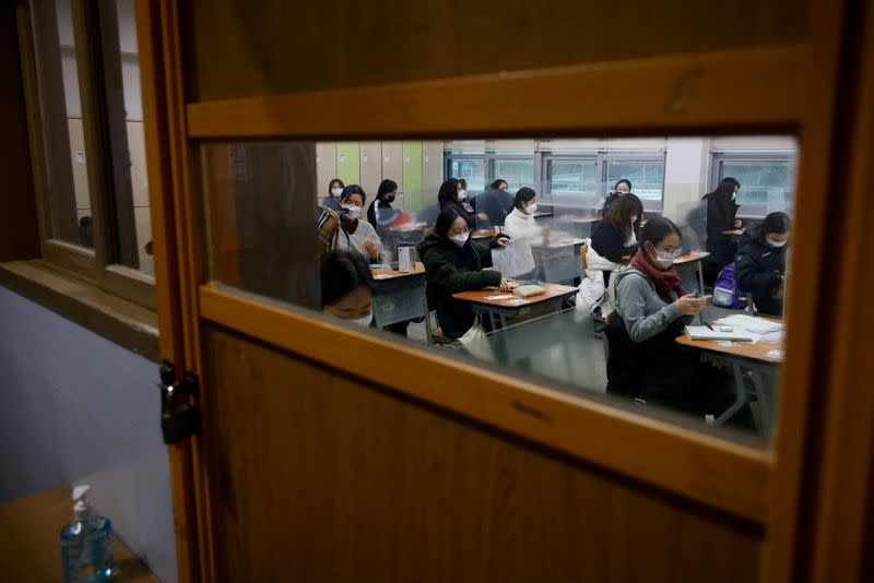 Students wait for the start of the annual college entrance examinations amid the coronavirus disease (COVID-19) pandemic at an exam hall in Seoul