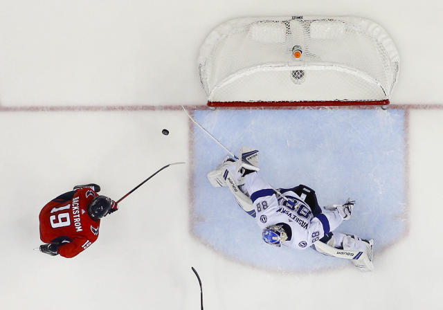 Tampa Bay Lightning goaltender Andrei Vasilevskiy (88) stops a shot by Washington Capitals center Nicklas Backstrom (19), from Sweden, during the third period of Game 4 of the NHL Eastern Conference finals hockey playoff series, Thursday, May 17, 2018, in Washington. (AP Photo/Pablo Martinez Monsivais)