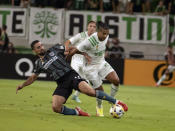 LA Galaxy forward Samuel Grandsir, left, tries to control the ball against Austin FC midfielder Cecilio Domínguez during the first half of an MLS soccer match, Sunday, Sept. 26, 2021, in Austin, Texas. (AP Photo/Michael Thomas)