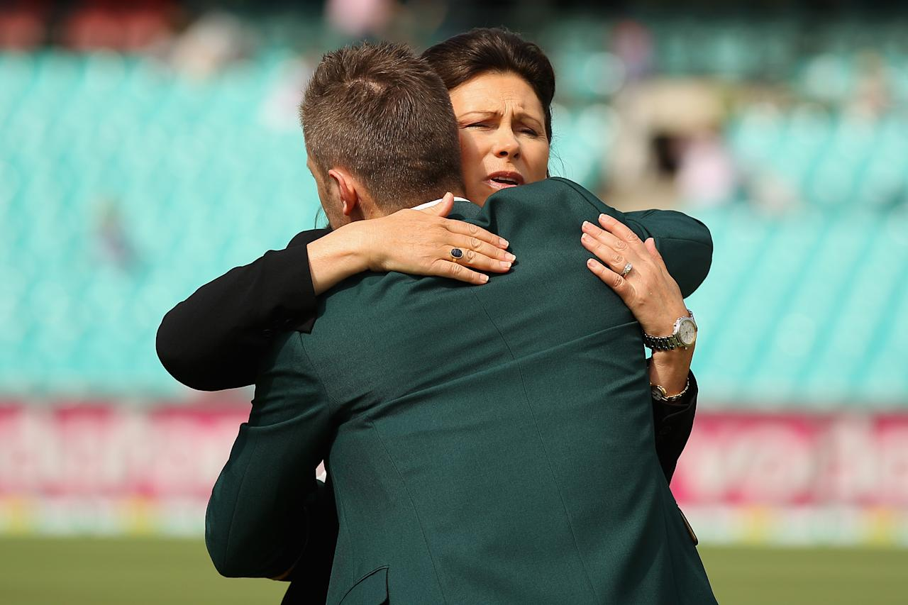 SYDNEY, AUSTRALIA - JANUARY 03:  Australian captain Michael Clarke embraces Vivian Greig, the wife of the late Tony Greig during day one of the Third Test match between Australia and Sri Lanka at Sydney Cricket Ground on January 3, 2013 in Sydney, Australia. Tony Greig was a former England test captain turned commentator who died of a heart attack on the 29th of December at age 66.  (Photo by Cameron Spencer/Getty Images)