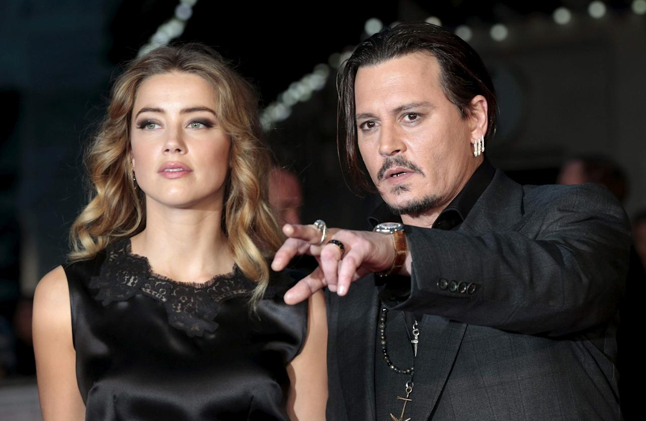 "Cast member Johnny Depp and his actress wife Amber Heard arrive for the premiere of the British film ""Black Mass"" in London, Britain October 11, 2015. REUTERS/Suzanne Plunkett/Files     TPX IMAGES OF THE DAY"
