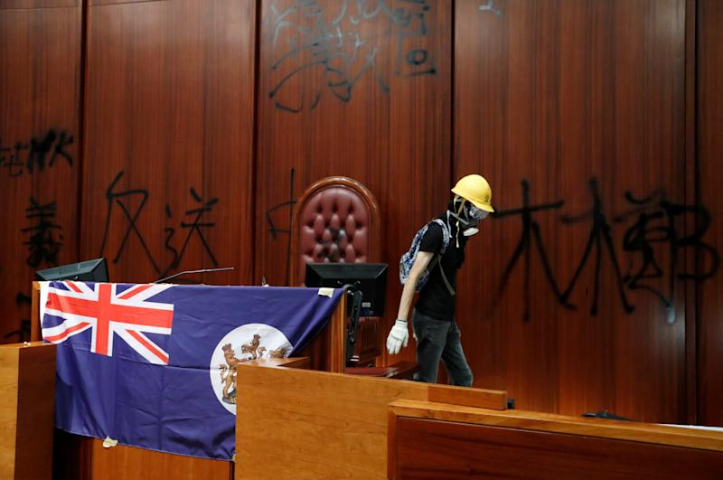 Colonial flag of Hong Kong is displayed inside a chamber after protesters broke into the Legislative Council building during the anniversary of Hong Kong's handover to China in Hong Kong, China July 1, 2019. (Photo: Tyrone Siu/Reuters)