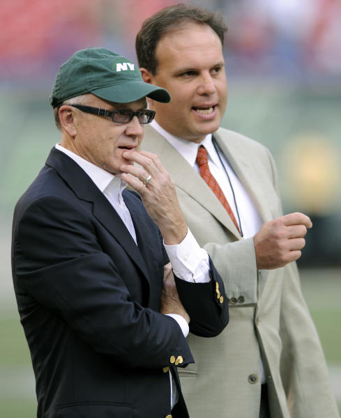 """FILE - In this Sept. 3, 2009 file photo, New York Jets Chairman and CEO Woody Johnson, left, and General Manager Mike Tannenbaum talk prior to an NFL preseason football game against the Philadelphia Eagles at Giants Stadium in East Rutherford, N.J. The New York Jets have fired Tannenbaum and say coach Rex Ryan will be back next season. Johnson said in a statement Monday, Dec. 31, 2012, that """"like all Jets fans, I am disappointed with this year's results."""" (AP Photo/Bill Kostroun, File)"""