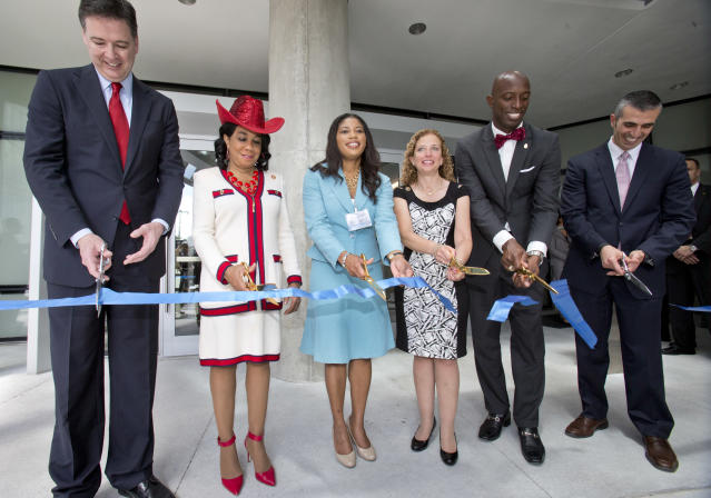Dignitaries cut a ribbon to mark the dedication of the Federal Bureau of Investigation's new $194 million South Florida field office in April. From left, FBI Director James Comey, U.S. Rep. Frederica Wilson, acting GSA Administrator Denise Roth, U.S. Rep. Debbie Wasserman Schultz, Miramar, Fla., Mayor Wayne Messam, and George Piro, Special Agent in Charge, FBI Miami. (Photo: Wilfredo Lee/AP)
