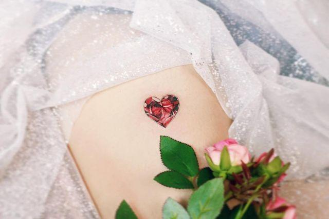 "<p>This itty-bitty <a href=""https://www.cosmopolitan.com/style-beauty/beauty/a8592530/heart-tattoos-designs/"" rel=""nofollow noopener"" target=""_blank"" data-ylk=""slk:heart design"" class=""link rapid-noclick-resp"">heart design</a> has a defined outline, but the watercolor detailing in the center makes it perfect for anyone wanting a colorful tat. </p><p><a href=""https://www.instagram.com/p/BnFdTREl_GC/"" rel=""nofollow noopener"" target=""_blank"" data-ylk=""slk:See the original post on Instagram"" class=""link rapid-noclick-resp"">See the original post on Instagram</a></p>"
