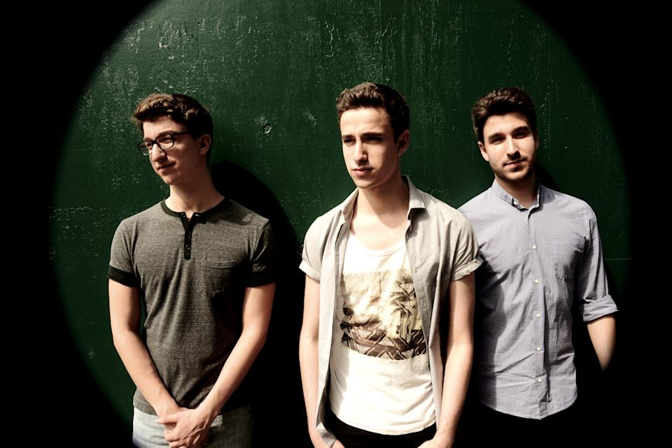 """AJR — three brothers born and raised in New York City — has achieved a startlingly quick levelof success with """"I'm Ready,"""" a buoyant electro-pop single that's taking off. The numbers:over 2.8 million YouTube views for I'm Ready, tens of thousands of singles sold each week,features in Billboard and the New York Post, and heavy airplay on pop radio's coveted SiriusXMHits 1"""" while climbing the Top 40 chart. Their tour dates last fall included shows with TheWanted, Demi Lovato, and Hoodie Allen.More amazing? They've done this all on their own.No pop svengali overseeing their work. No studio musicians filling in the blanks. No Max Martinco-write. Simply a DIY pop group that writes, records, and produces everything themselves fromthe living room of their Chelsea apartment.So let's meet the intriguing Met brothers — Adam (bass/vocals), a 23-year old ColumbiaUniversity graduate. Ryan (guitar/piano/vocals), a bespectacled 20-year old Columbia studentwho serves as the band's main songwriter (in addition to AJR's music, he has also co-writtenAndy Grammer's hit single """"Back Home""""). And Jack (vocals/guitar), the 16-year old force-ofnaturewho splits time between lead vocals and attending high school in NYC.From an early age, music was the brothers' passion. """"After realizing that the three of us couldsing, we immediately started harmonizing, taking cues from classic bands like Simon Garfunkeland The Beach Boys,"""" Adam remembers. Eight years ago, AJR got their musical start busking inCentral Park and Washington Square, singing Jackson 5 covers, and, later, their own material.They took those busking earnings to buy musical instruments, equipment, and Pro Tools. Overtime, they realized that they could get the sound they needed just recording in the living roomwith their $99 microphone, which is where they still record today.As they were practicing, some interesting sounds started to appear. """"We were combining oldermusic, from the '50s and '60s, with more modern music,"""" explains Ryan, """