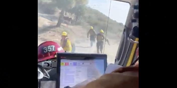 """A bull chased a crew of firefighters down a road while they responded to the Lake Fire in Southern California on Friday. <p class=""""copyright""""><a href=""""https://twitter.com/VCFD/status/1294438570480898048"""" rel=""""nofollow noopener"""" target=""""_blank"""" data-ylk=""""slk:Twitter/@VCFD"""" class=""""link rapid-noclick-resp"""">Twitter/@VCFD</a></p>"""