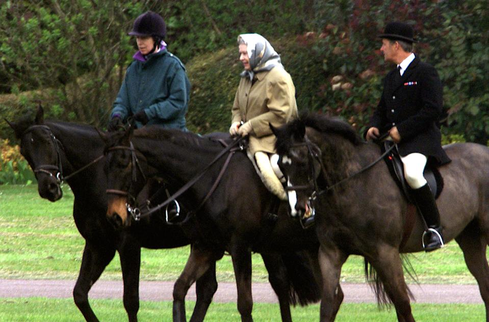 EMBARGOED TO 2230 SUNDAY MAY 31 File photo dated 1/4/2002 of Queen Elizabeth II and her daughter, the Princess Royal, riding near Windsor Castle. The Queen has been seen riding her horse this weekend in Windsor Home Park as she has been in residence at Windsor Castle during the coronavirus pandemic.
