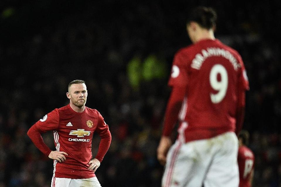 Manchester United's striker Wayne Rooney (L) anmd Manchester United's Swedish striker Zlatan Ibrahimovic react during the English Premier League football match against Hull City February 1, 2017 (AFP Photo/Oli SCARFF )