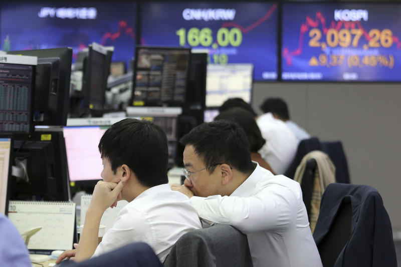 Currency traders watch monitors at the foreign exchange dealing room of the KEB Hana Bank headquarters in Seoul, South Korea, Monday, Oct. 28, 2019. (AP Photo/Ahn Young-joon)