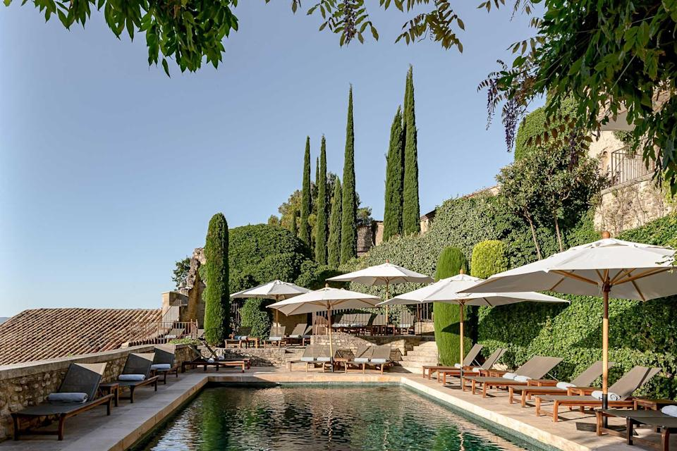 Pool and umbrellas at the Crillon le Brave resort in France, voted one of the best hotels in the world