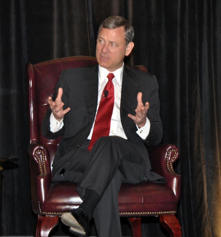This photo provided by the U.S. Courts Circuit Executive's Office shows Chief Justice of the U.S. Supreme Court, John Roberts, participating in a program at Nemacolin Woodlands Resort that is part of the Science and the Law program by the Judicial Conference of the District of Columbia Circuit in Farmington, Pa. on Friday, June 29, 2012. (AP Photo/Ann Wilkins/US Courts Circuit Executive's Office)