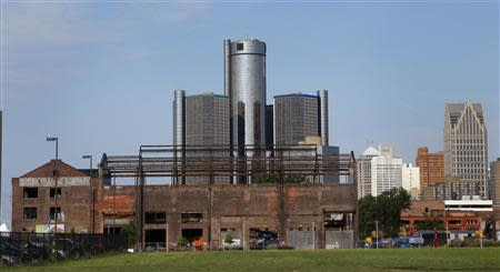 General Motors World Headquarters is seen behind a historic warehouse being restored along the Detroit River in Detroit