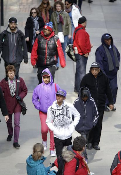 In this photo taken March 13, 2013, pedestrians walk in New York's Times Square. An historic decline in the number of U.S. whites and the fast growth of Latinos are blurring traditional black-white color lines in the U.S. The demographic shift is now a potent backdrop to an immigration overhaul bill, being debated in Congress, that could offer a path to citizenship for 11 million mostly Hispanic illegal immigrants. (AP Photo/Seth Wenig)