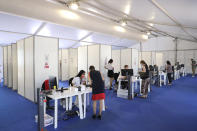 A festival coronavirus testing center is seen at the 74th international film festival, Cannes, southern France, Tuesday, July 6, 2021. (Photo by Vianney Le Caer/Invision/AP)